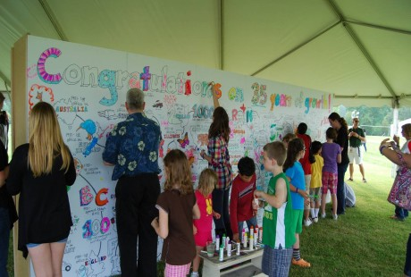 Guests sign their congratulations on 35 years of growth on a message board at the SAS Spring Festival